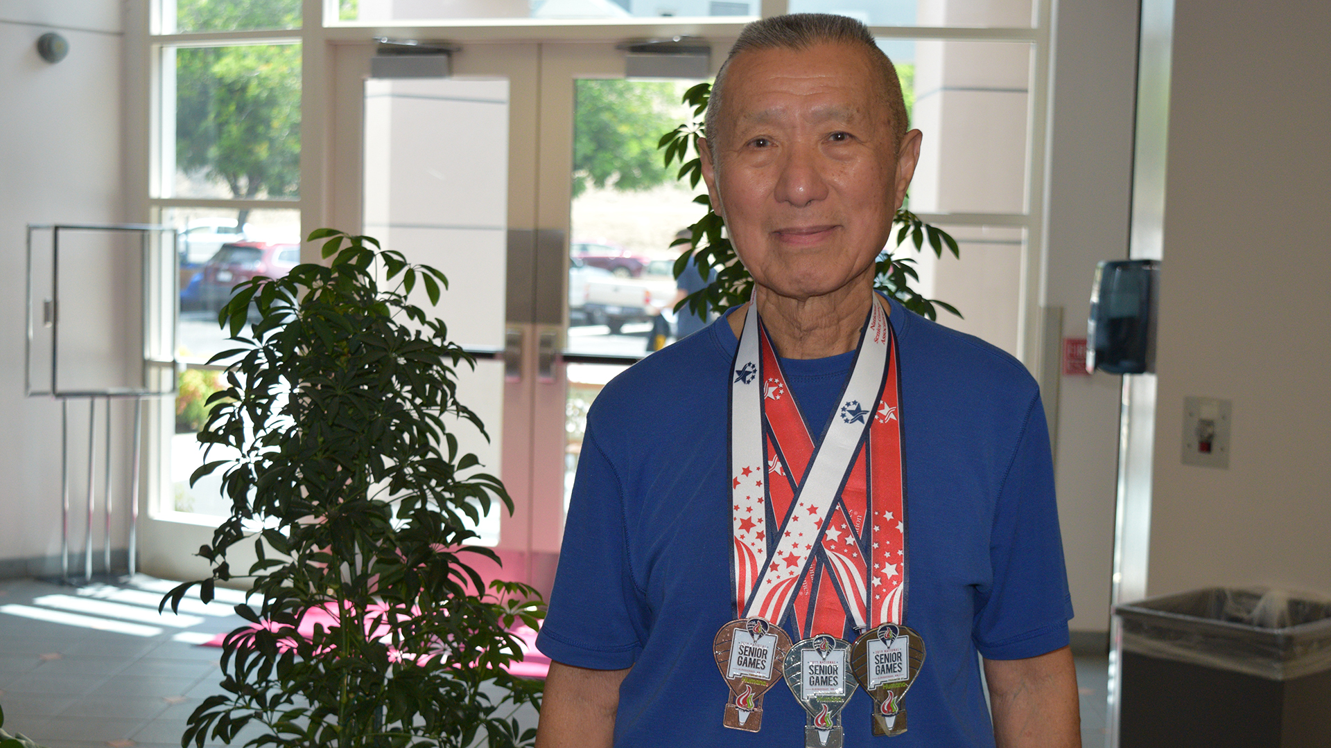 James Ho and his three medals