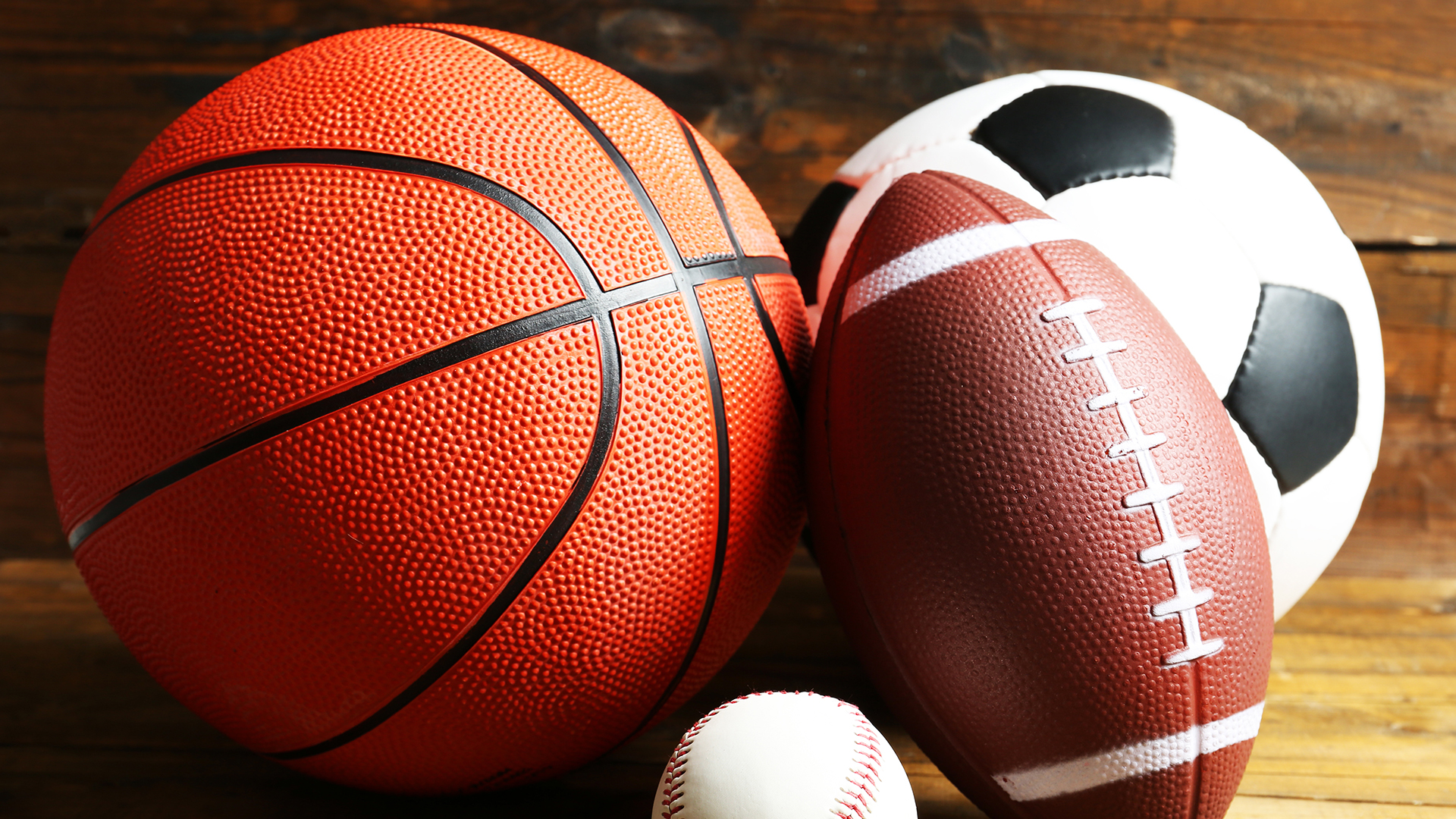 Basketball, baseball, football, and soccer