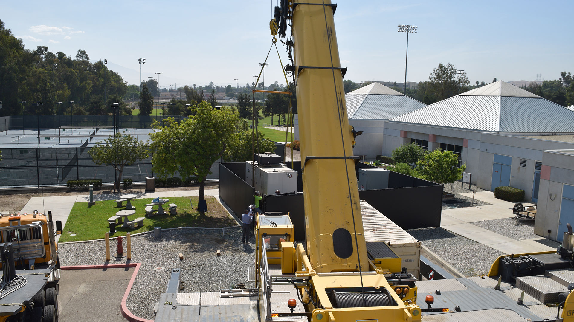A giant crane moves Drayson Center's new generator into place